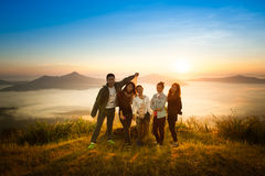 Sunrise on misty mountain with women and man stock images