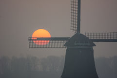 Sunrise misty winter morning with windmill Royalty Free Stock Images