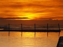 Sunrise on Mona Vale beach. Sunrise and Mona Vale rock-pool Royalty Free Stock Image