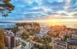 Sunrise in Monaco: Port Fontvieille and Rock of Monaco. Sunrise in Monaco: View of port Fontvieille and Rock of Monaco with old town Stock Photography