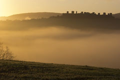 Sunrise in Monteriggioni. Sunrise with fog near Castle of Monteriggioni Royalty Free Stock Photography