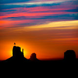 Sunrise at Monument Valley at Mittens and Merrick Butte. Sunrise at Monument Valley West and East Mittens and Merrick Butte with crow Utah Stock Photos