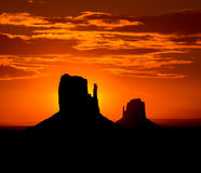 Sunrise at Monument Valley West and East Mittens Butte Stock Image
