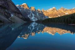 Sunrise at Moraine lake in Banff National Park, Canada. Stock Photos
