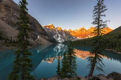 Sunrise at Moraine lake in Rocky Mountains, Banff National Park, Canada. Royalty Free Stock Photography