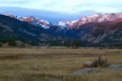 Sunrise on Moraine Park in Rocky Mountain National Park. The mountain peaks light up with the morning sun at Rocky Mountain National Park stock photos