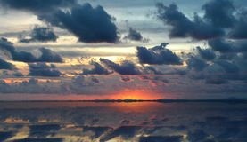 Sunrise morning in cloudy of rainy season and the refection Royalty Free Stock Image