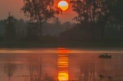 Sunrise and morning fog Stock Photos
