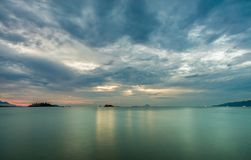 Sunrise Morning Ocean Nha Trang Vietnam. Nha Trang Vietnam sunrise with a cloudy grey sky over a turquoise ocean long exposure Stock Images