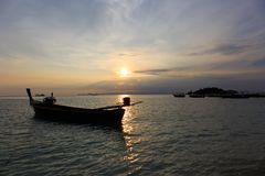 Sunrise, morning sea, colorful sky. The sun is up in the morning, the sea is beautiful, the sky is beautiful, there is a long tail boat in summer Stock Images