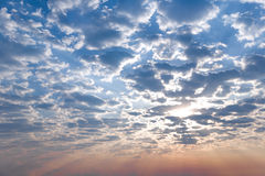 Sunrise, morning sky and big fluffy clouds. Sunrise, morning blue sky and big fluffy clouds royalty free stock photo