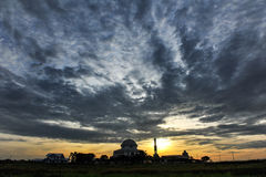 Sunrise. A mosque with the sunset view near the paddy field Stock Images