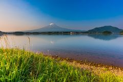 Sunrise at mount Fuji with reflection on lake kawaguchiko. Beautiful sunrise at mount Fuji with reflection on lake kawaguchiko in Yamanashi, Japan royalty free stock image