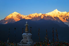 "Sunrise Mount Kawa Karpo. Sunrise Tibetan pilgrimage mountain Mount Kawa Karpo. As one of the most important pilgrimage sites in Tibet, Kawakarpo (or ""Kagebo Stock Image"