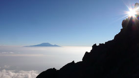 Sunrise on Mount Meru with Kilimanjaro in the background stock image