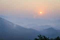 Sunrise, mountain and fog in the morning Royalty Free Stock Image