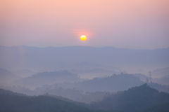 Sunrise, mountain and fog in the morning Royalty Free Stock Photo