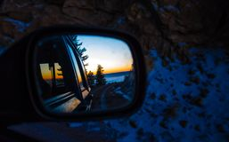 Mirror view of sunrise on a mountain stock photography