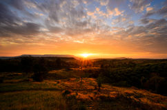Sunrise in the mountain landscape Stock Photos