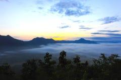 Sunrise on mountain in mist Royalty Free Stock Photos