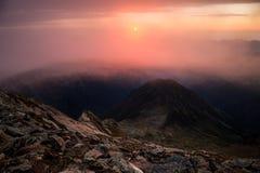 Sunrise on a mountain peak stock photo