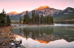 Sunrise Mountain reflection on the lake Stock Photography