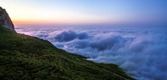 Sunrise in mountain. Thick clouds at the foot of Сrimea mountai Royalty Free Stock Images