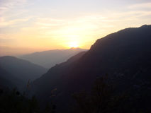 Sunrise by the mountain valley. Sun is about to rise by the mountains stock images
