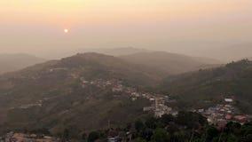 Sunrise mountain village stock video footage