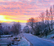 Sunrise and mountain village road Stock Photo