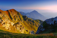Sunrise in mountains. The first beams of a rising sun shine mountains Carpathians, Ukraine Royalty Free Stock Photo