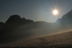 Sunrise in the mountains. Above a glacier royalty free stock images