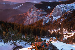 Sunrise into the mountains. Sunrise moment on top of the mountains during winter Royalty Free Stock Photography
