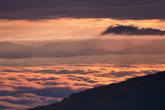 Sunrise in the mountains above the clouds. Beautiful sunrise on the hill above clouds. Carpathians, Borzhava Royalty Free Stock Images