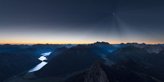 Sunrise in mountains of austrian alps with moonlight Stock Photography