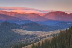 Sunrise in the mountains Stock Images