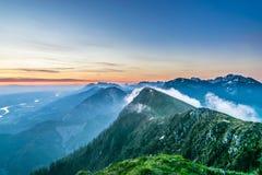 Sunrise in mountains Stock Photos