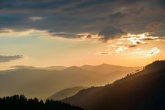 Sunrise in the mountains. The beginning of a sunny day for a walk in the mountains. Dawn in the mountains. Carpathians Stock Photos