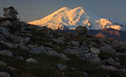 Sunrise in the mountains of the Caucasus. Morning. The first rays of the sun. View of the Elbrus Stock Images