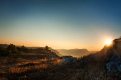 Sunrise in mountains Stock Images
