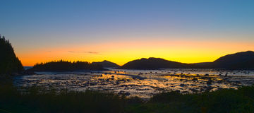 Sunrise in mountains at low tide Royalty Free Stock Image