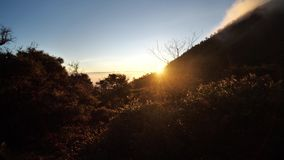 Sunrise in the mountains. Over sky background stock video footage