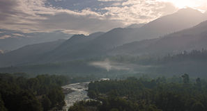 Sunrise among the mountains and river Stock Images