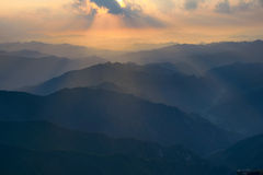 Sunrise in mountains Stock Image