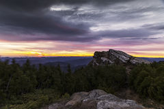 Sunrise in the mountains with spectacular sky one morning stormy Stock Image