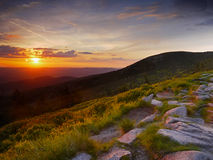 Sunrise Mountains. Stone hiking trail and a sunrise in the mountains stock photo