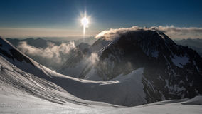 Sunrise in the mountains. The sun rises in the Altai Mountains Stock Images