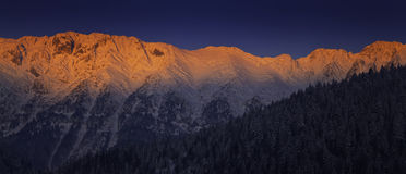 Sunrise in the mountains in winter Royalty Free Stock Photos