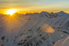 Sunrise in the mountains in winter Stock Photography
