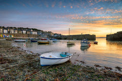 Sunrise at Mousehole in Cornwall. Beautiful sunrise over fishing boats in the harbour at Mousehole near Penzance in Cornwall Stock Image
